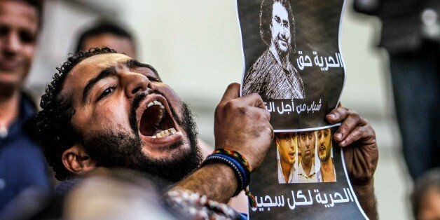 CAIRO, EGYPT - FEBRUARY 11:  A protester is seen during a demonstration demanding the release of imprisoned journalists, in f