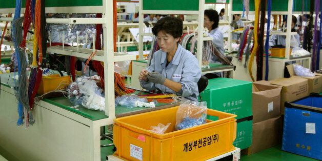 In this Sept. 21, 2012 photo, a North Korean worker handles wires at a South Korean-run factory inside the Kaesong industrial