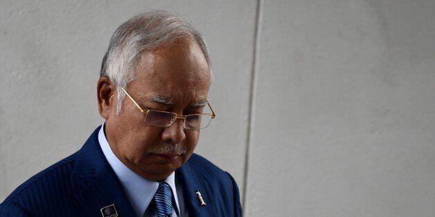 To go with Malaysia-politics-corruption-Saudi,FOCUS by Dan Martin  Malaysia's Prime Minister Najib Razak leaves his office a