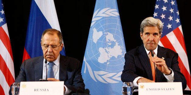 U.S. Secretary of State John Kerry, right, and Russian Foreign Minister Sergey Lavrov arrive for a news conference after the
