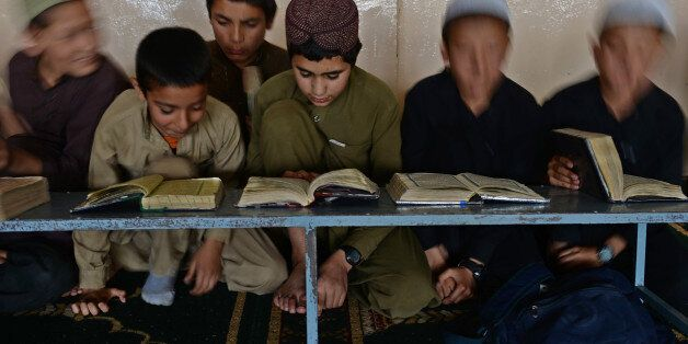 Afghan boys learn and memorize Koran at a Madrassa during the month of Ramadan in Kabul on July 15, 2013. Throughout the mont