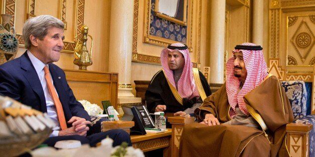 US Secretary of State John Kerry (L) meets with Saudi King Salman bin Abdulaziz (R) on January 23, 2016 at the King's farm, o