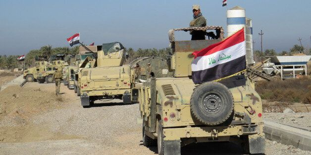 Iraqi government forces patrol the al-Hamidiyah area, north of Ramadi, on February 17, 2016 after security forces retook the