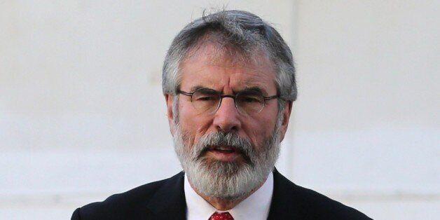 Irish republican politician and president of the Sinn Féin political party Gerry Adams talks to the press on December 4, 201