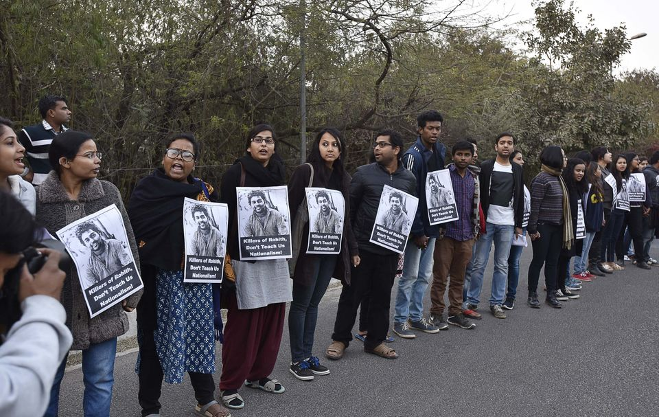 NEW DELHI, INDIA - FEBRUARY 14: JNU teachers and students form a human chain inside the campus in protest against arrest of J