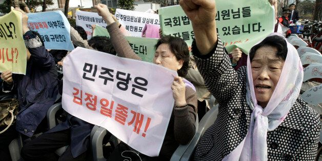 Former North Korean defectors shout a slogan during a rally demanding the improvement of North Korean's human rights near the