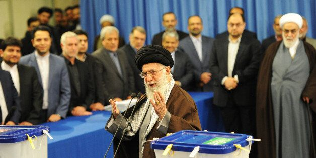 TEHRAN, IRAN - FEBRUARY 26: Iran's Supreme Leader Ayatollah Seyyed Ali Khamenei casts the first ballot in key elections for P