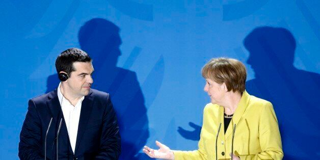FILE - In this March 23, 2015 file photo German Chancellor Angela Merkel, right, and the Prime Minister of Greece Alexis Tsip