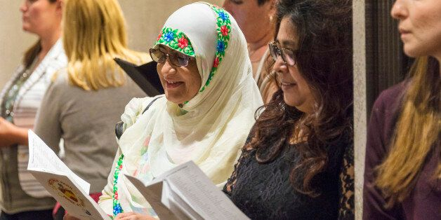 TORONTO, ONTARIO, CANADA - 2015/06/25: Muslim woman integrated to Canadian society, they partake in a High School graduation