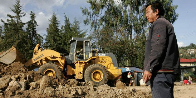 A Chinese construction worker supervise the building of a road, Thursday, April 26, 2007 in the Ethiopian capital, Addis Abab