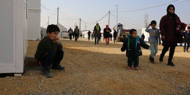 TABANOVCE, MACEDONIA - FEBRUARY 23: Refugees, who are stuck in Macedonia as Serbia does not let them to pass border, wait at