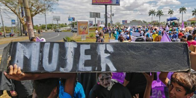 People take part in a march during the International Women Day in Managua on March 8, 2016. The march was to demand an intern
