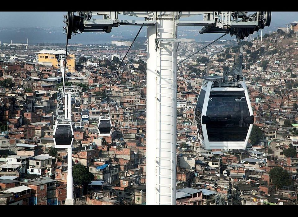 Cable cars ferry passengers over the Complexo do Alemao favelas in Rio de Janeiro, Brazil.  A six-station gondola line, the n