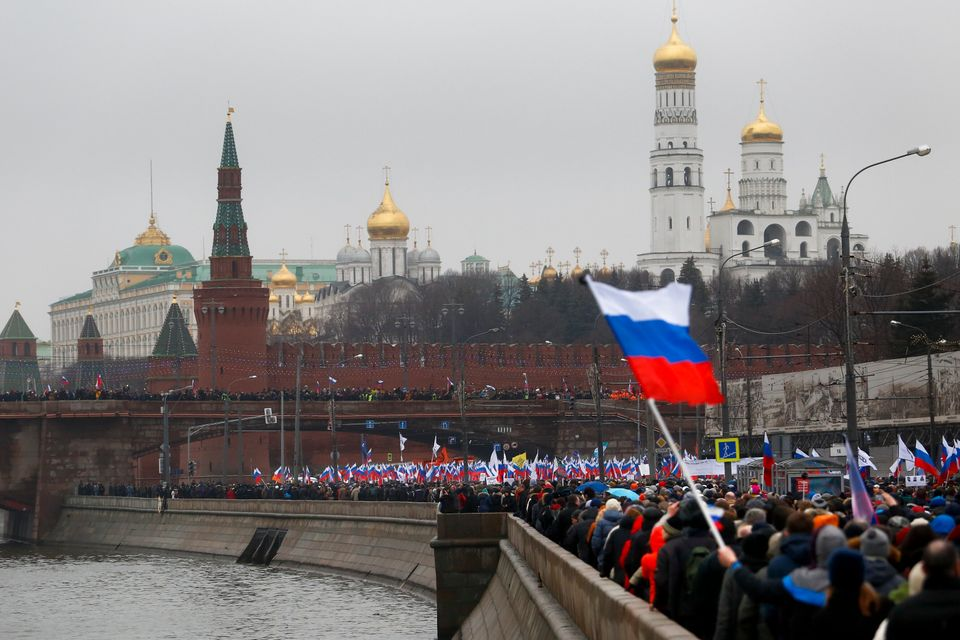 People with Russian national flags march in memory of opposition leader Boris Nemtsov, who was gunned down on Friday, Feb. 27
