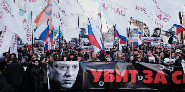 MOSCOW, RUSSIA - FEBRUARY 27: Supporters of slain Russian opposition leader Boris Nemtsov hold a banner reading 'Killed for f