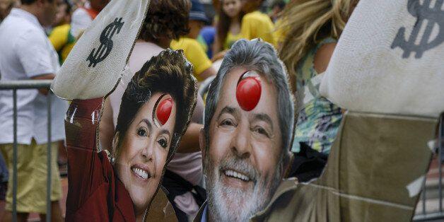 Cardboard cut out figures in the likenesses of Luiz Inacio Lula Da Silva, former president of Brazil, and Dilma Rousseff, Bra