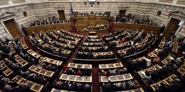 Greek lawmakers vote during the third round of a three-stage presidential election at the Greek parliament in Athens, on Dece