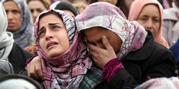 TOPSHOT - The sister (L) of Mohammed Ismael, who died in one of three suicide car bombings claimed by the Islamic State (IS)