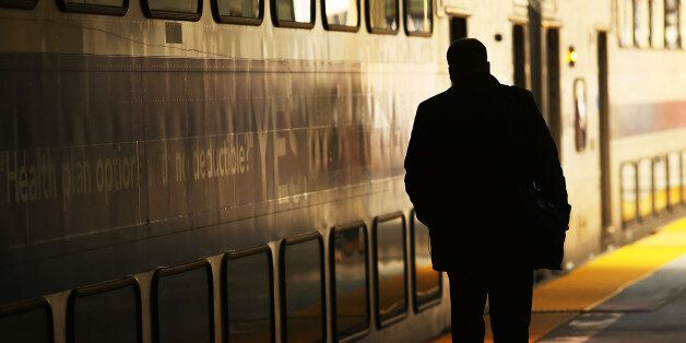 NEWARK, NJ - MARCH 08: A man walks along a NJ Transit train platform as a strike looms on one of the nations most popular com