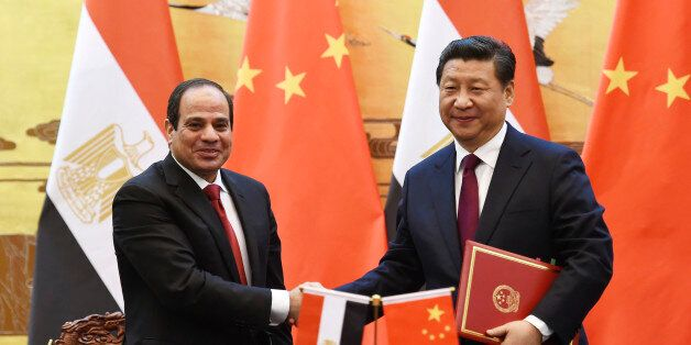 Egypt's President Abdel-Fattah el-Sissi, left, shakes hands with Chinese President Xi Jinping during a signing ceremony in Be