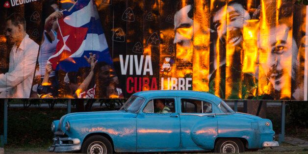 """A taxi driving a classic American car passes a billboard that reads in Spanish: """"Long live free Cuba"""" in Havana, Cuba, Monday"""