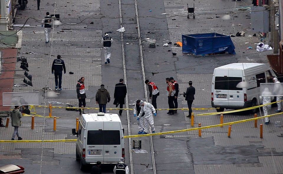 Emergency services at the scene of an explosion, on a street, in Istanbul, Turkey, Saturday, March 19, 2016. An explosion on