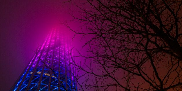 BEIJING, CHINA - MARCH 19:  Guangzhou Tower with lights on before the 2016 Earth Hour event on March 19, 2016 in Guangzhou, C