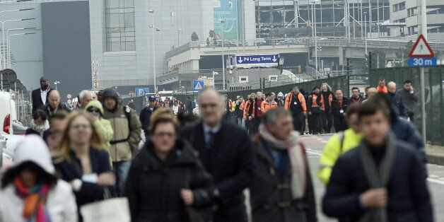 People are evacuated from Brussels Airport, in Zaventem, on March 22, 2016.  after at least 13 people have been killed by two