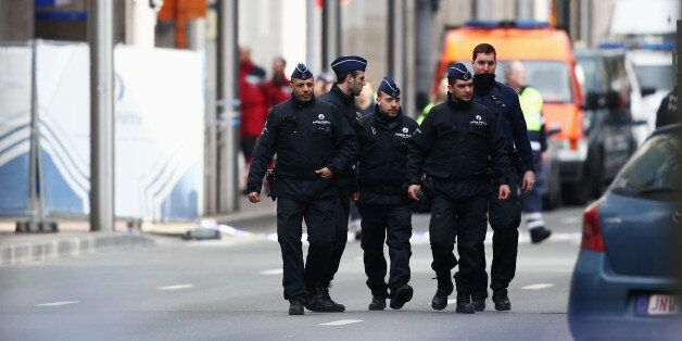 BRUSSELS, BELGIUM - MARCH 22:  Police officers patrol outside Maelbeek metro station following todays attack on March 22, 201