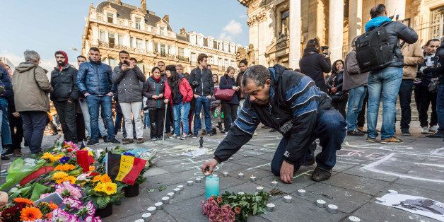 People light candles in the shape of a heart outside the stock exchange in Brussels on Tuesday, March 22, 2016. Explosions, a