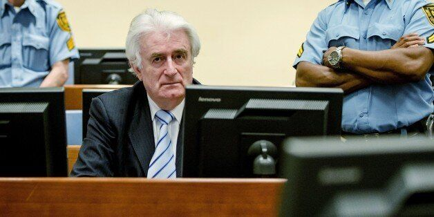 Bosnian Serb wartime leader Radovan Karadzic sits in the courtroom for the reading of his verdict at the International Crimin