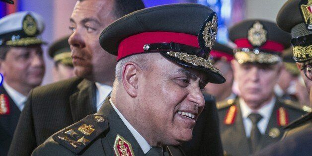 Egyptian Defence Minister Sedki Sobhi talks with officials at the end of the closing session of a conference gathering the De