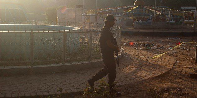 LAHORE, PAKISTAN - MARCH 28: Pakistani commando stand guard at the suicide blast site in Lahore on March 28, 2016.  At least