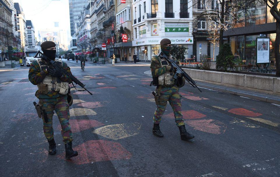 Belgian troops patrol a street in Brussels on Monday, Nov 23.