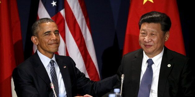U.S. President Barack Obama shakes hands with Chinese President Xi Jinping during their meeting at the start of the  climate