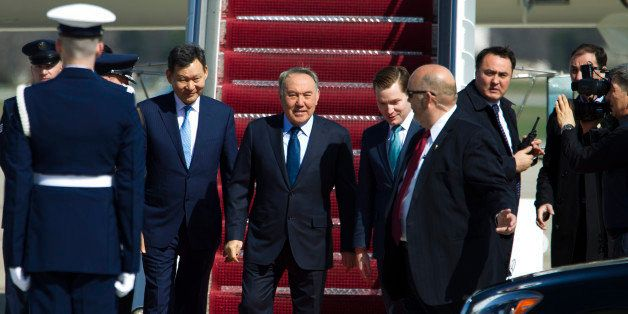 Kazakhstan President Nursultan Nazarbayev walks down the stairs from a plane upon his arrival at Andrews Air Force Base, Md.,