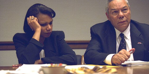 U.S. Secretary of State Colin Powell (R) and National Security Advisor Condoleezza Rice in the President's Emergency Operatio