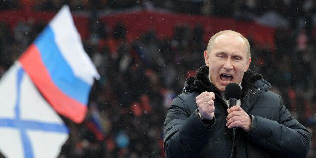 Russian Presidential candidate, Prime Minister Vladimir Putin delivers a speech during a rally of his supporters at the Luzhn
