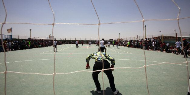 AL-AZRAQ, JORDAN - APRIL 30: Syrian refugees play soccer in the Al-Azraq camp for Syrian refugees on April 30, 2015 in Al-Azr