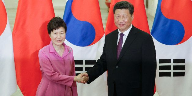BEIJING, CHINA - SEPTEMBER 02:   Chinese President Xi Jinping (R) shankes hands with South Korean President Park Geun-hye (L)
