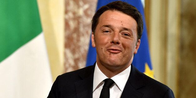 Italy's Prime minister Matteo Renzi gives a press conference at the Chigi Palace on April 7, 2016 in Rome, to present the nat