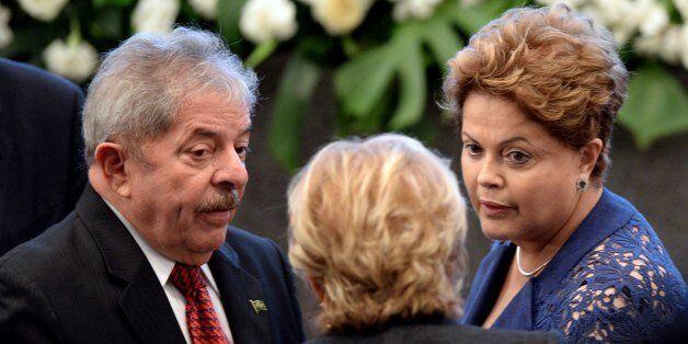 Brazilian President Dilma Rousseff (R) and former President Luiz Inacio Lula da Silva participate in the celebration for the