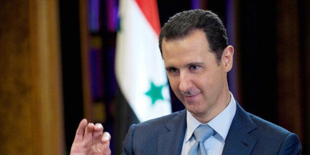 FILE - In this Feb. 10, 2015, file photo released by the Syrian official news agency SANA, Syrian President Bashar Assad give