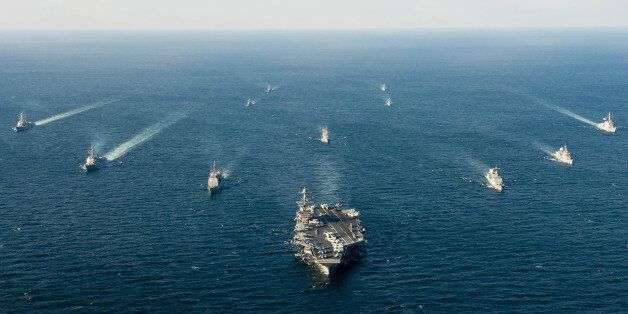 U.S. and South Korean naval ships traverse the ocean in formation as part of Foal Eagle 2016 in the waters surrounding the Ko