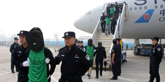 FILE - In this file photo taken April 13, 2016, and released by Xinhua News Agency, Chinese and Taiwanese suspects involved i