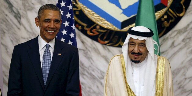 U.S. President Barack Obama (L) stands next to Saudi Arabia's King Salman during the summit of the Gulf Cooperation Council (