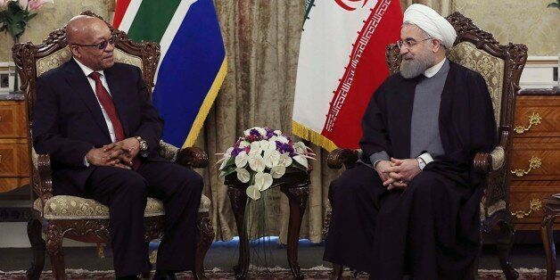 In this photo released by the official website of the office of the Iranian Presidency, President Hassan Rouhani, right, meet