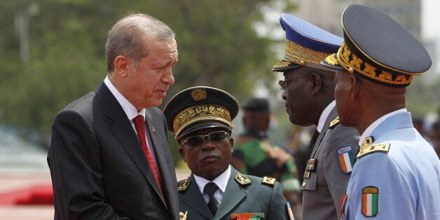 Turkey's President Tayyip Erdogan shakes hands with Ivorian officers while Ivory Coast's army chief Soumaila Bakayoko (2nd L)