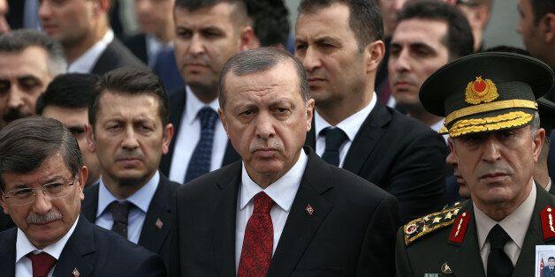 Turkey's President Recep Tayyip Erdogan, center, Prime Minister Ahmet Davutoglu, left, Chief of Staff Gen. Hulusi Akar, right