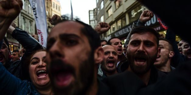 Protesters shout slogans on Istiklal Avenue in Istanbul on April 27, 2016, during a protest against a call for the country to
